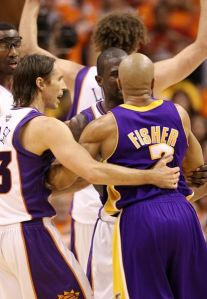 Derek Fisher is held back by Steve Nash and Jason Richardson