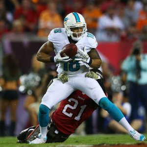 hi-res-187704035-rishard-matthews-of-the-miami-dolphins-tries-to-break_crop_exact