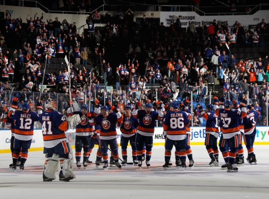 UNIONDALE, NY - FEBRUARY 10: The New York Islanders celebrate their 3-2 victory over the Edmonton Oilers at the Nassau Veterans Memorial Coliseum on February 10, 2015 in Uniondale, New York.  (Photo by Bruce Bennett/Getty Images)
