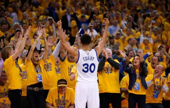 OAKLAND, CA - MAY 21: Stephen Curry #30 of the Golden State Warriors reacts after a basket in the fourth quarter against the Houston Rockets during game two of the Western Conference Finals of the 2015 NBA PLayoffs at ORACLE Arena on May 21, 2015 in Oakland, California. NOTE TO USER: User expressly acknowledges and agrees that, by downloading and or using this photograph, user is consenting to the terms and conditions of Getty Images License Agreement. (Photo by Ezra Shaw/Getty Images)